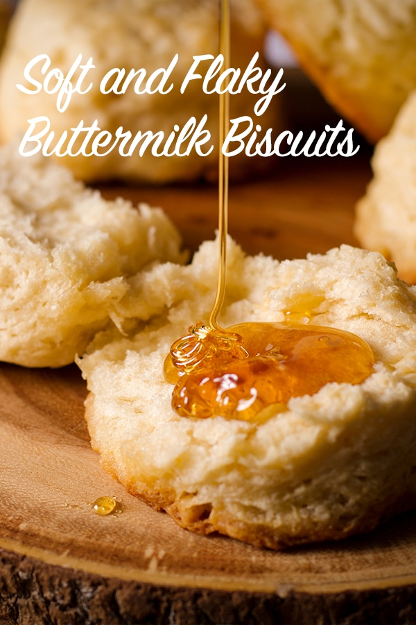 Drizzling a buttermilk biscuit with honey.