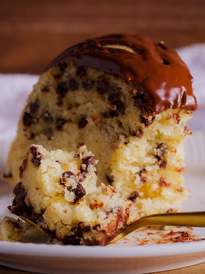 Using a fork to take a bite of chocolate chip Bundt Cake.