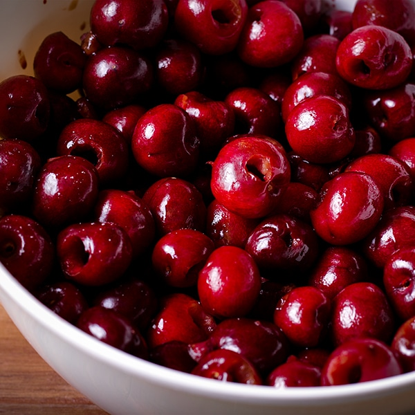 A bowl of freshly pitted sweet cherries.
