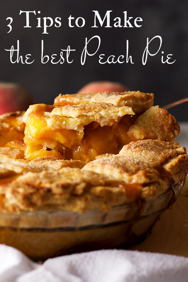 Using a pie server to serve a slice of homemade peach pie.