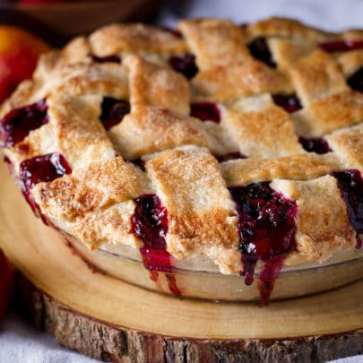 A berry pie with a flaky lattice crust that's been dusted with sugar.
